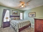 The master bedroom sleeps 2 in a plush queen bed.