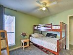 The second bedroom includes a twin-over-full bunk bed.