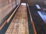 Shared Gameroom shuffleboard table