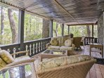 This 2,600-square-foot home sleeps 10 guests and features an expansive covered deck, a fire pit, decorative pinball...