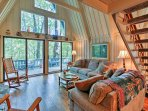 Soak in the scenic views from the spacious, A-frame living area.