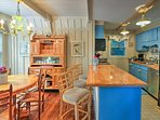 Enjoy a glass of wine and snacks around the 3-person kitchen bar.