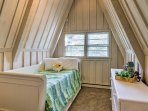 Wake up to scenic views in this light and airy bedroom with a twin bed.