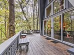 You'll enjoy the sights and sounds of the forests from the extensive porch system.