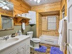 Get ready for the day in this bathroom with walk-in shower and separate bathtub.