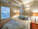 Wrap up in the cloud-like linens of this queen bed.