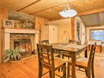 Wine and dine at the tall 4-person table next to the gas fireplace.