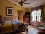 The master bedroom has plenty of floor space and windows - at Ashemount in Sugar Grove, NC.