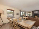 One great room, many places to be - Dining Table, Breakfast Bar and Couch with TV and Gas Fireplace