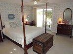 Master Bedroom with Queen Bed, Sliding Glass Door to Deck and Full Bathroom
