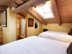 The loft bedroom has an en-suite bath, a flat screen tv, and vaulted ceilings