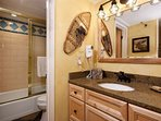 The master bath on the main level has a separate vanity area, perfect for a larger group