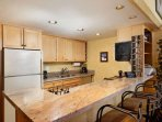 You can make a delicious meal in this fully stocked kitchen.  The breakfast bar provides dining for 4.