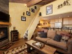 Warm western decor compliments this open living area.  The lofted bedroom offers an additional retreat for family or...