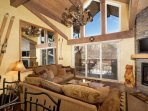 Floor to ceiling windows in the living room provide great views of the surrounding Snowmass area mountains.