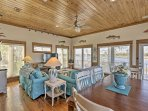 Matching hardwood floors and ceilings coupled with charming beach-themed accents throughout bring the coastal essence...