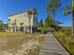 Situated on the Carrabelle River, this waterfront home offers a private dock, ideal for fishing or setting sail onto...