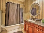 The home's 3 full bathrooms and 2 additional half baths provide guests with comfort and privacy.