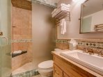 The steam shower in the master bathroom is exactly what you'll need after a long day of skiing.