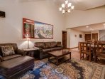 The ornate living area features large leather couches and a map of the famous Telluride Ski Resort.