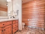 This second bathroom offers a spacious walk-in shower.