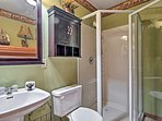 Freshen up after shredding the slopes in this pristine walk-in shower.