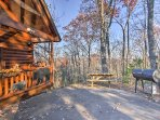 Enjoy the beautiful outdoors at this log cabin.