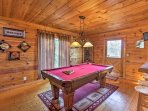 Stay entertained in the game room featuring a pool table and flat-screen cable TV.