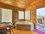 Admire the surrounding beauty from the jacuzzi tub in the master bedroom.