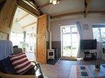 Log burner and lounge view