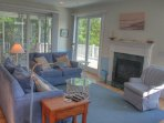 Living Room w/ Queen Sleeper, Fireplace, and access to rear deck & screened porch