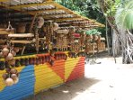 Take home a locally-made souvenir from this colourful shop on the beach at Englishman's Bayn