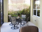 Outside dining area within screened lanai