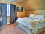 The bedroom offers a comfy queen bed.