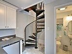 The spiral staircase leads up to the bedroom.