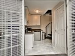 French doors open into the well-equipped kitchenette.