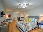 The spacious bedroom is decorated with stylish and bright accent pieces.