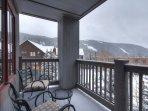 Back Deck - The deck boasts views of the surrounding mountains.