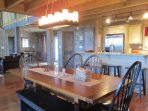 "Your group will gather to ""break bread"" and then stay to chat at the large wooden dining table with comfortable..."