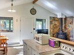 Open to the living room is the well-equipped kitchenette.