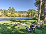 Walk out the back door and enjoy views of the river, lush vegetation, and rolling hills.