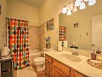 Rise and shine with a refreshing shower in the full bathroom with a shower/tub combo.