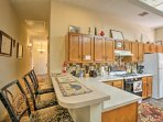 Keep the chef company at the breakfast bar with seating for 3.