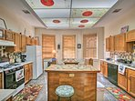 This vibrant and fully equipped kitchen boasts everything you need to whip up home-cooked meals for your travel...