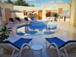 Pool Area including Pool & Jacuzzi, deckchairs & umbrellas, BBQ Area, Toilets& Shower.