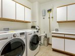 Large laundry room with full size washer and dryer for your convenience.
