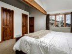 Bright windows in the entry level master to enjoy the mountain views.