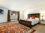 Spacious, main level master bedroom with king bed and flat screen TV.