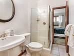 Lower level guest bath can be privately accessed from bedroom 3 or from the hallway.