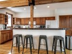 Plan your daily adventures at this breakfast bar for 4 (please note new stainless appliances have been installed).
